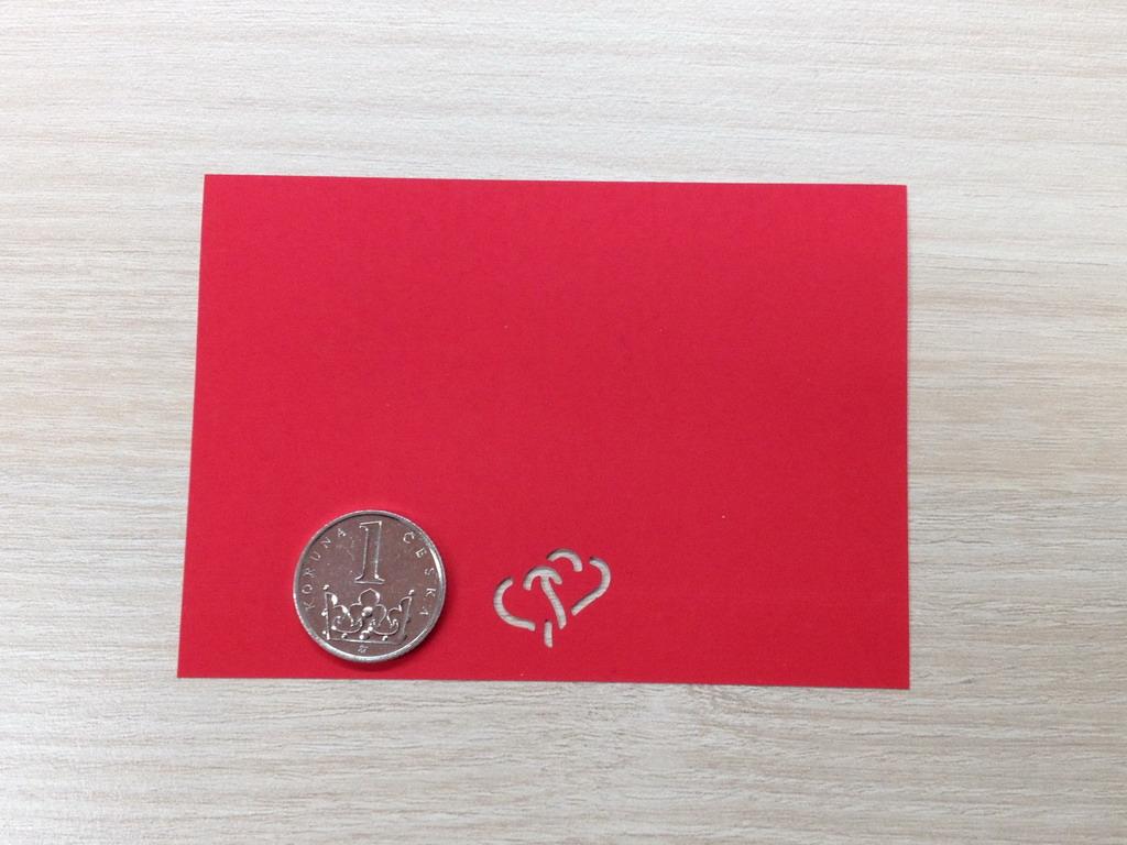 Ozdobná děrovačka 15 mm - propletená srdce